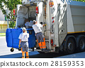 Garbage truck works in the city street 28159353