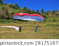 paraglider preparing to launch itself in the air 28175167