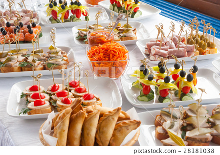 canapes on the white plates 28181038