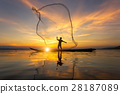 Silhouette of Myanmar fisherman on wooden boat 28187089