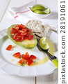 Avocado stuffed tomatoes 28191061