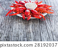 Boiled red crayfish, on an old wooden table 28192037
