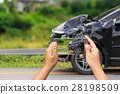 Black car get damaged by accident on the road 28198509