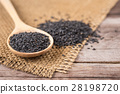 Close up black sesame in bowl and spoon on wooden plank 28198720
