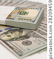 Stack of money in US dollars cash banknotes 28209459
