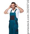 Worker in green uniform with protective earphones 28209716