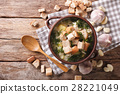 Soup with garlic and croutons close-up 28221049