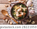 Delicious garlic soup with croutons in a bowl 28221050