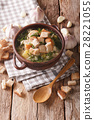 Delicious garlic soup with croutons in a bowl 28221055