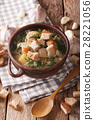 Traditional soup with garlic and croutons close-up 28221056