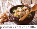 Thick garlic soup with croutons close-up 28221062
