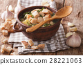 Homemade garlic soup with croutons close-up 28221063