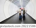 Senior couple in hallway of subway pulling trolley 28221586