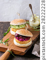 Vegan burgers with avocado, beetroot and sauce 28222228