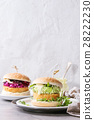 Vegan burgers with avocado, beetroot and sauce 28222230