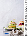 Vegan burgers with avocado, beetroot and sauce 28222234