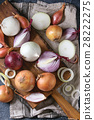 Variety of whole and sliced onion 28222275
