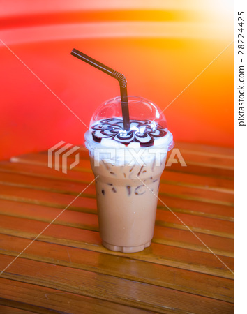 Iced coffee to go on wood table. 28224425