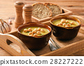 Vegetable cream soup with croutons on wooden tray. 28227222