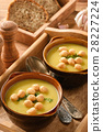 Vegetable cream soup with croutons on wooden tray. 28227224