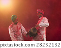 Two Young Indian men With Colored Face Dancing During Holi Color festival 28232132