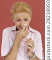Senior Women Blowing Nose Concept 28238950