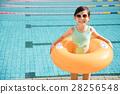 happy little girl having fun  in swimming pool 28256548
