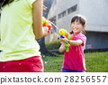 happy little girls  playing water guns in the park 28256557