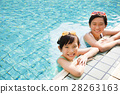 happy little girls having fun  in swimming pool 28263163