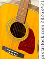 Close up on a well used wooden guitar 28263421