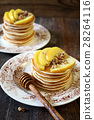 Pancake with honey, caramelized apples and walnuts 28264116