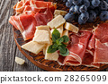 Prosciutto, wine, grape, parmesan on wooden table. 28265099