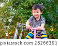 Asian kid riding seesaw board at the playground 28266391