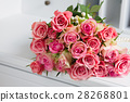 Pink blooming roses on wood 28268801