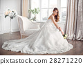 Bride in beautiful dress sitting resting on sofa 28271220