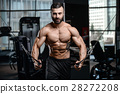 Fitness instructor handsome muscle man in the gym 28272208