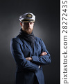 Portrait of a handsome sailor on a dark background 28272435