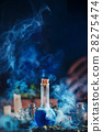 Blue magical potion with clouds of rising smoke 28275474
