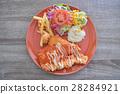 Breaded fried chicken. 28284921