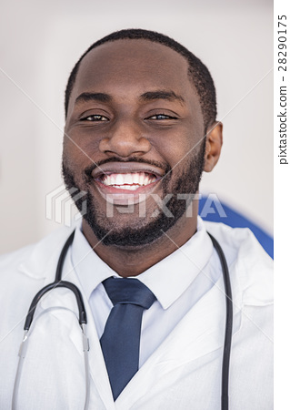 Face of happy doctor situating in hospital 28290175