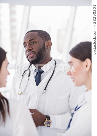 Serene medical advisers standing in clinic 28290201