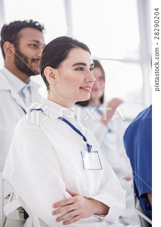 Cheerful medical adviser watching lecture in 28290204