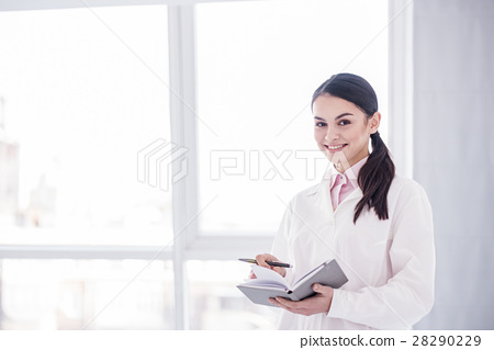 Cheerful physician situating in hospital office 28290229