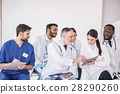 Interested doctors watching at notebook in 28290260