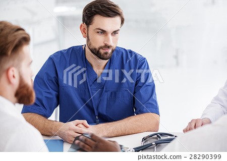 Outgoing doctor situating with colleagues during 28290399