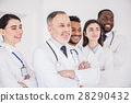 Cheerful team of doctors standing together 28290432