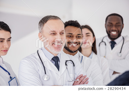 Smiling doctors standing in polyclinic 28290434
