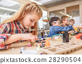 Cheerful team of little technicians 28290504