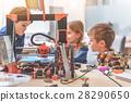 Interested children talking in workshop 28290650