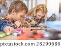 Busy children in light studio 28290686